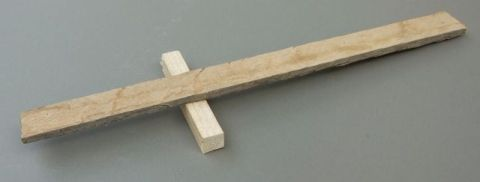 The lever, a paint stirr stick or piece of sawn wood about 35 centimeter long, (the same as the base board of the launcher), is glued to the fulcrum, and secured with two small nails or a small screw. Use the yellow carpenters' glue from a hardware store. That is acually a good all purpose glue!